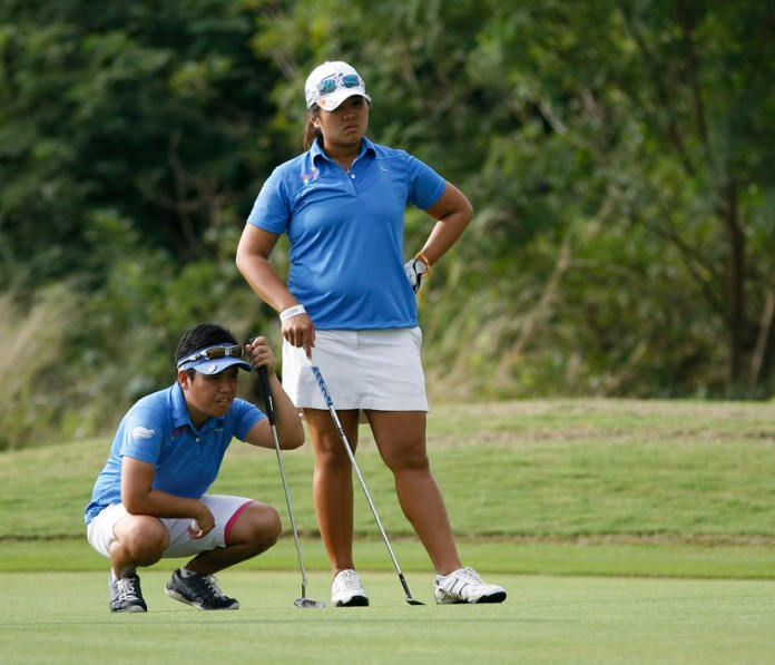 Lovelynn Guioguio (left) and Mia Piccio read the line of their putt on No. 8 then provided the crucial 1-up win over Dottie Ardina and Mary Grace Estuesta to preserve Team South's 4-point lead over the North squad in the ICTSI LPGT Duel 2 at South Links.