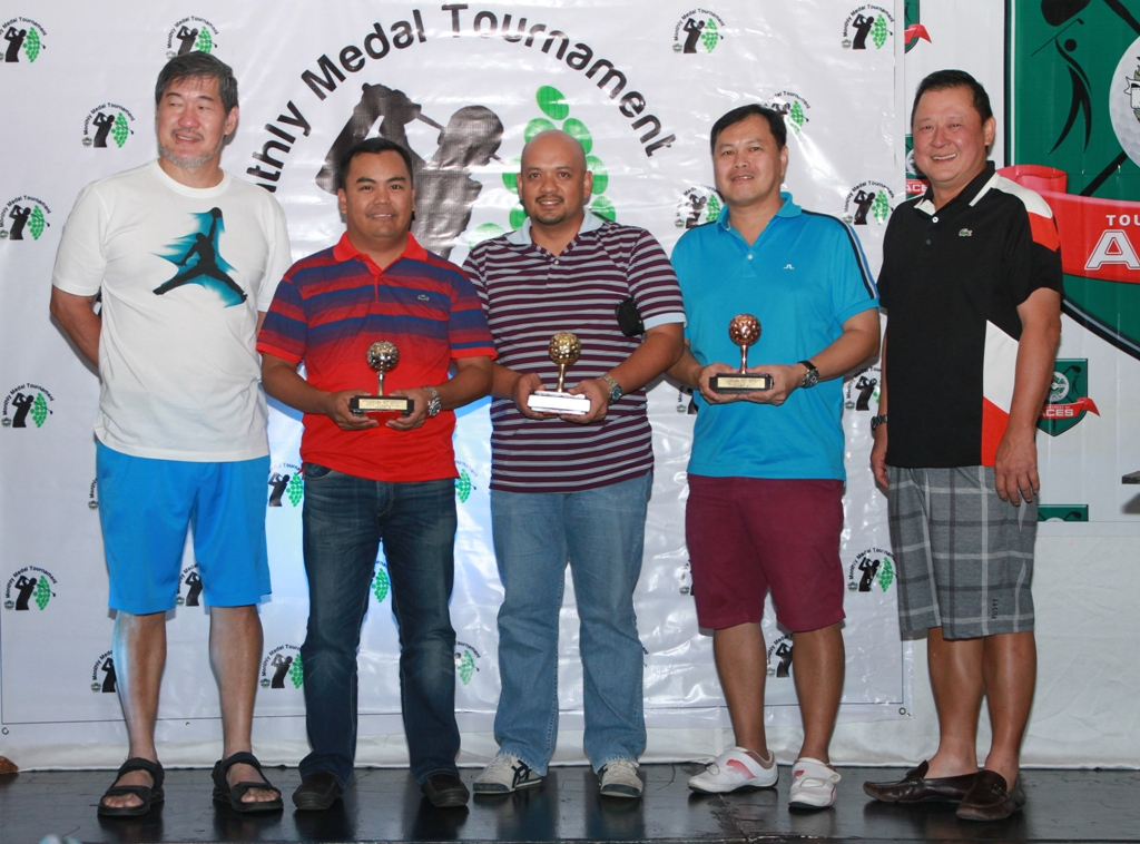 Ramon Sebastian and Willy Go awarded the trophies to the class B winners.  They are (from left) Lowest net Archie Villa, lowest gross Anthony Bejar, and runner-up Richard Lim.