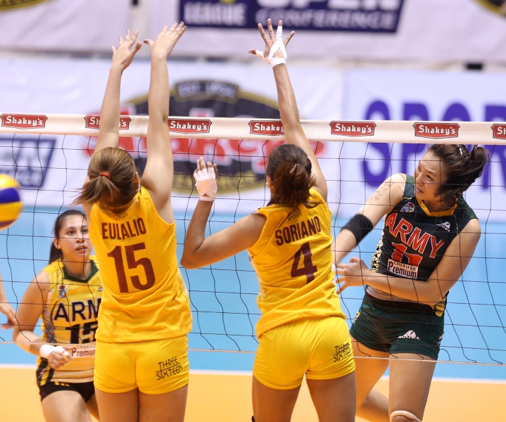 Army's Honey Royse Tubino (right) bangs away a spike against Cagayan Valley's Wenneth Eulalio and Pau Soriano during their faceoff for the second finals berth in the Shakey's V-League Season 12 Open Conference at The Arena in San Juan.