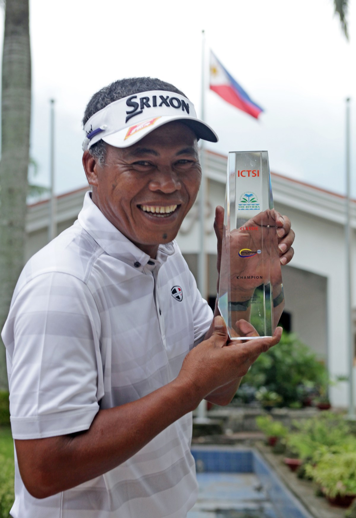 Elmer Salvador beams as he holds his trophy after beating Miguel Tabuena, Tony Lascuna and Rufino Bayron to retain the ICTSI Riviera Classic crown.