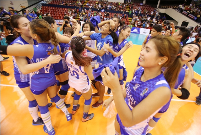 Members of Pocari Sweat whoop it up at centercourt after beating Air Force in four in their sudden death for the Shakey's V-League Season 13 Open Conference crown at the Philsports Arena in Pasig Monday.
