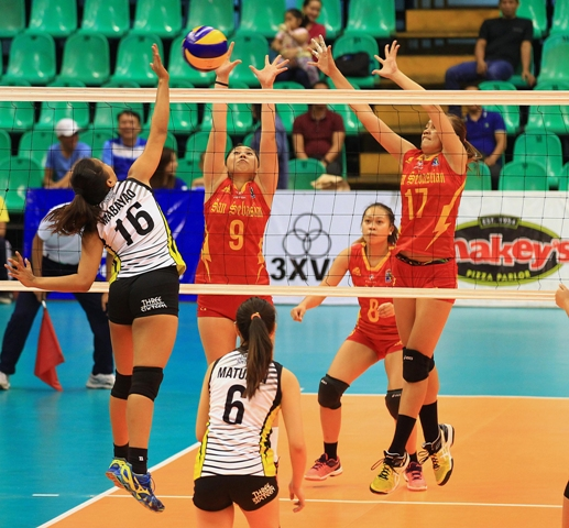 TIP's Eunice Mabayao (16) goes for a power tip against SSC's Vira Guillerma (9) and Ferina Saet during their Shakey's V-League encounter at the Philsports Arena.