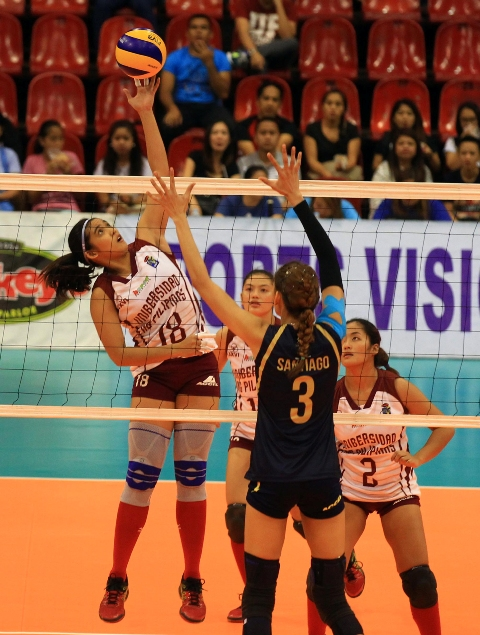 Diana Carlos (18) of UP goes for a drop shot against NU's Jaja Santiago during their key Shakey's V-League Collegiate Conference encounter at the Philsports Arena.