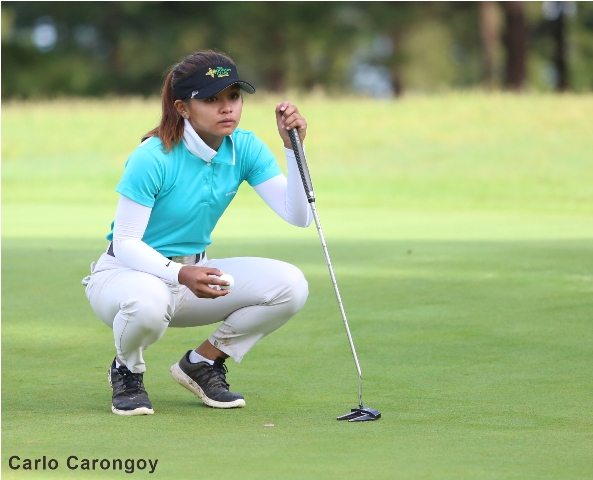 Mikhaela Fortuna lines up her putt during the third round of the 11th Philippine Airlines Ladies Interclub golf team championships at the Camp John Hay golf course.
