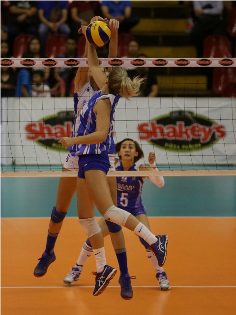 Pocari Sweat's Breanna Lee Mackie (partly hidden) foils BaliPure import Kaylee Manns attack as Melissa Gohing prepares to provide help during their Shakey's V-League Reinforced Conference duel at the Philsports Arena.