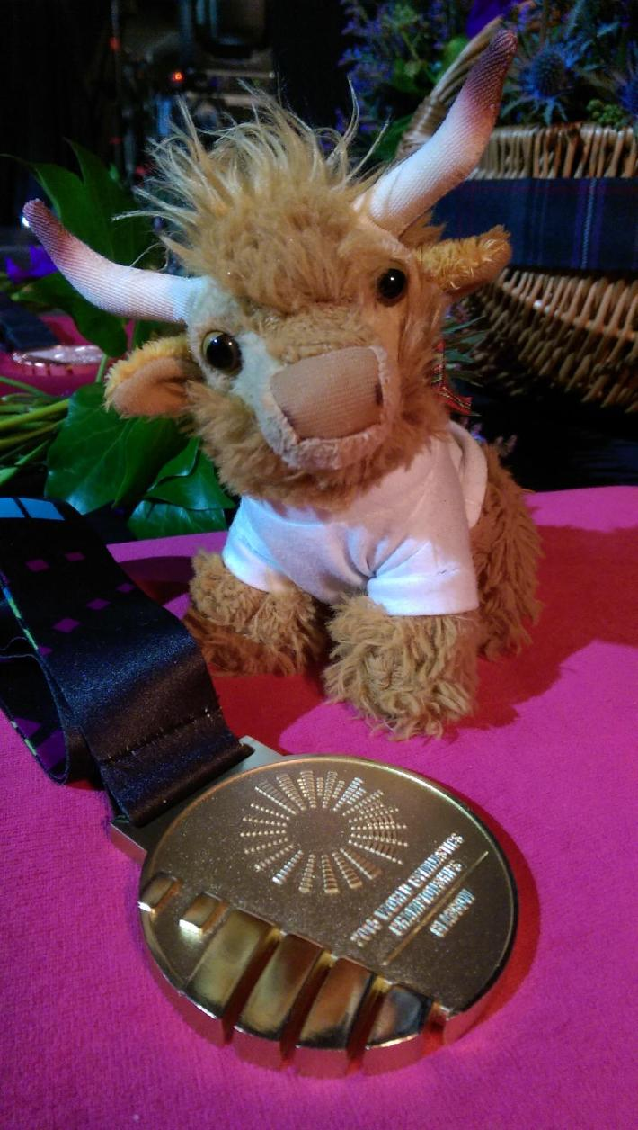 Medal and highland coo soft toy with World Gymnastics Championships 2015