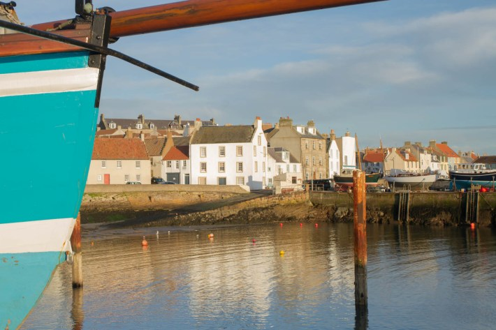St Monans, Fife, Scotland. Image shows harbour with houses on each side