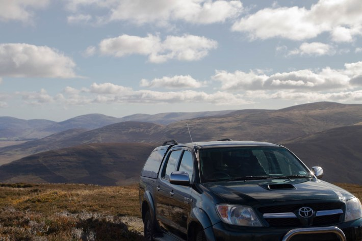 Glenesk Wildlife tour, 4x4 off road vehicle up on the hillside. Large clouds overhead
