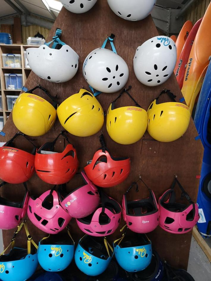 Beyond Adventure, SUP experience. Helmets on the rack
