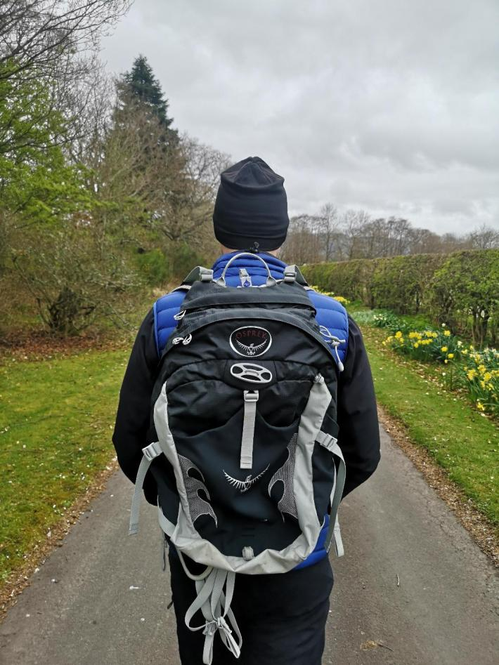 Photo of a man out walking wearing a rucksack
