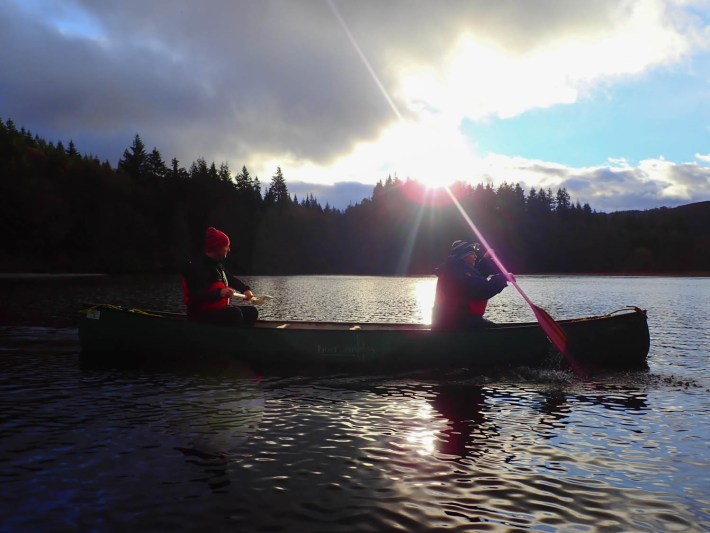 Photo of a man and woman in a canoe.