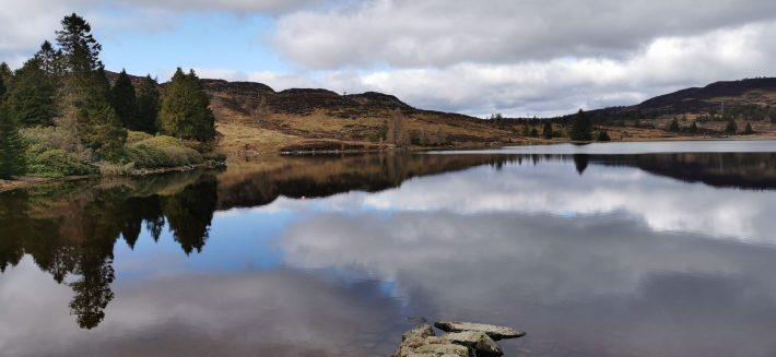 Image of: Reflections of the clouds on Loch Ordie, Perthshire