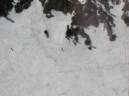 Skiers photographed from the tram