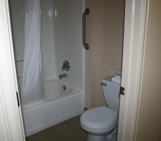 Nice full bathtub/shower combinations with separate vanity areas upstairs and down.