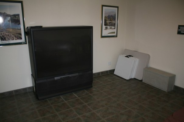 TV room, with a fairly dated and seldom used TV.