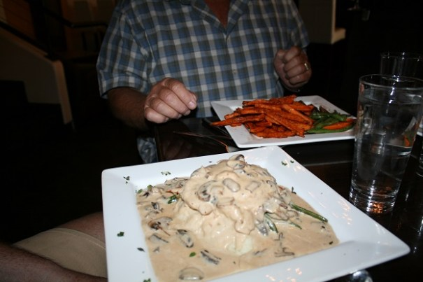 Mike's Chicken Marsala, you can just see Pat's Flat Iron Steak with sweet potato fries and vegetables.