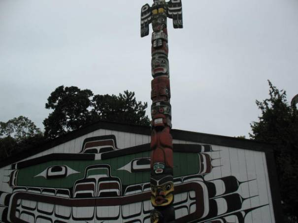 Totem painting on building side at Thunderbird Park.