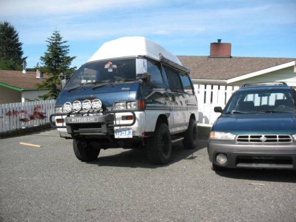 I made Edie take this picture: Mitsubishi AWD, winch, camper top, 4 extra lights, perhaps my penchant, weird cars.