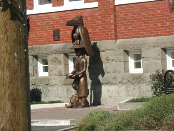 Metal sculpture of wooden totem.