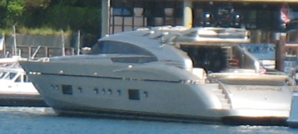 This is a huge and really handsome boat.  Looks like it is made of stainless steel, brushed.  Great design.