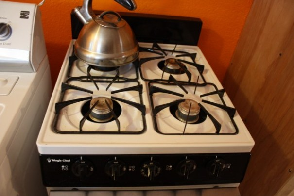 Four burner stove with oven and broiler.