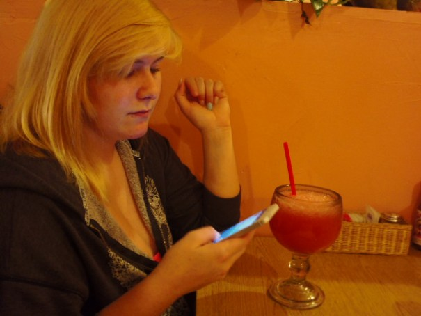 Two of her favorite activities, texting and margaritas.