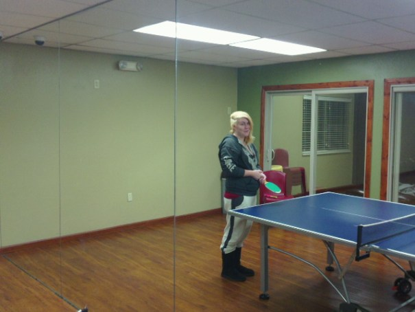Lex in the mirror playing ping pong.