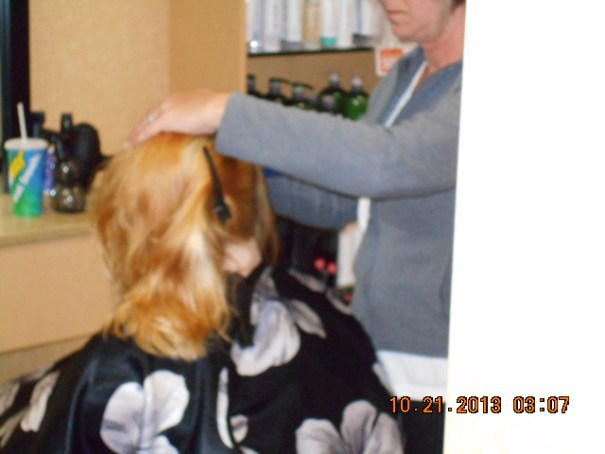 Getting her hair cut.