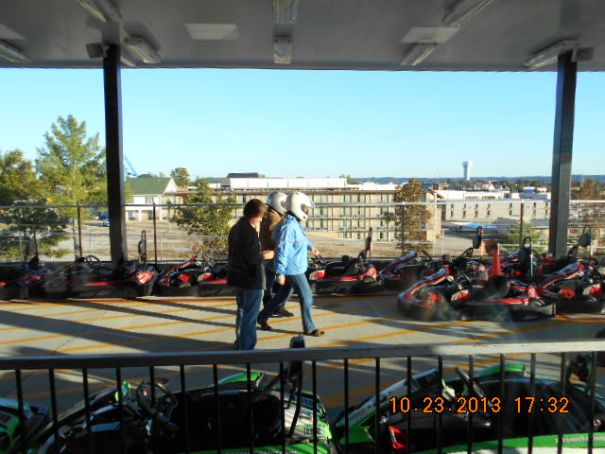 They start in the slower red go carts.  I can already see Edie's aggression.