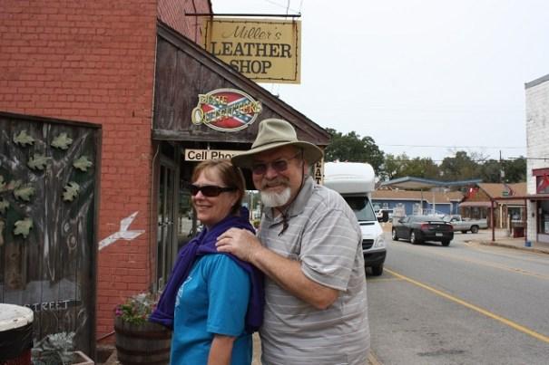 Grumpy old man grabbing pretty woman.