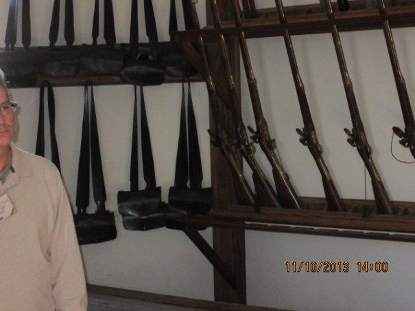 Cartridge bags hanging on the wall.  Replica guns on the rack.