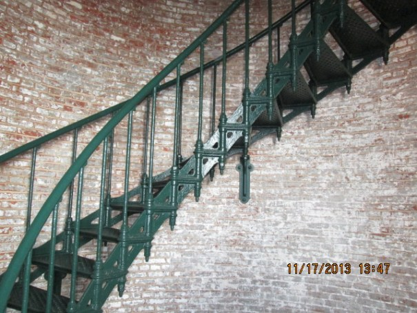 Great custom stairs.  Iron, with I'd guess about a hundred coats of paint.  Nice style and nice and solid.