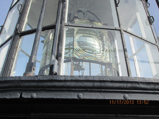 French physicist Augustin-Jean Fresnel came up with a glass structure that forced almost all the light to shine straight out like a spot light.  Really improved safety for ships.  It is called a fresnel lens to this day.