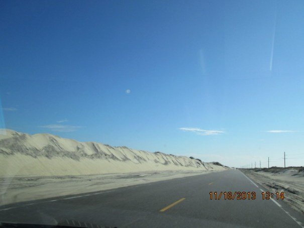 Wind, sand, and a determination to keep the road free of sand.