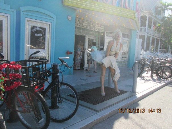 A small little theater with a larger than life Marilyn Monroe out front.