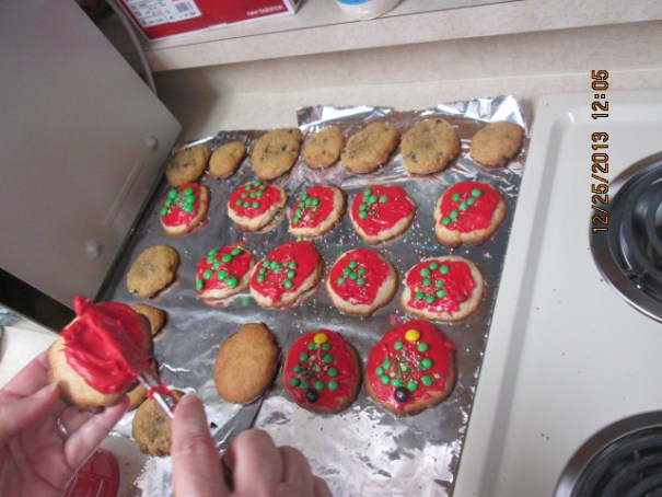 Chocolate chip and frosted sugar cookies.  The cookies spell Merry Xmas in mini m&m's and she made two Christmas Trees.