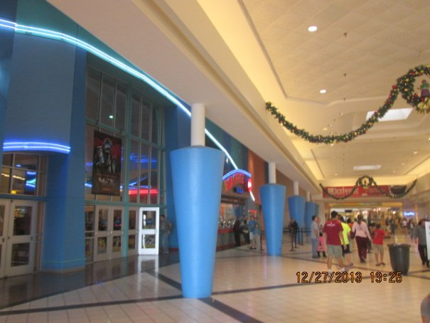 Theaters on the left, food court on the right, mall straight ahead.