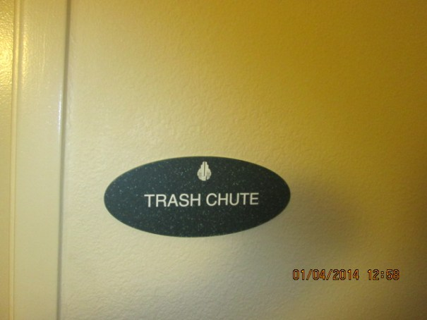 """Edie took the garbage out just before we left and she was fascinated with the """"Trash Chute""""."""