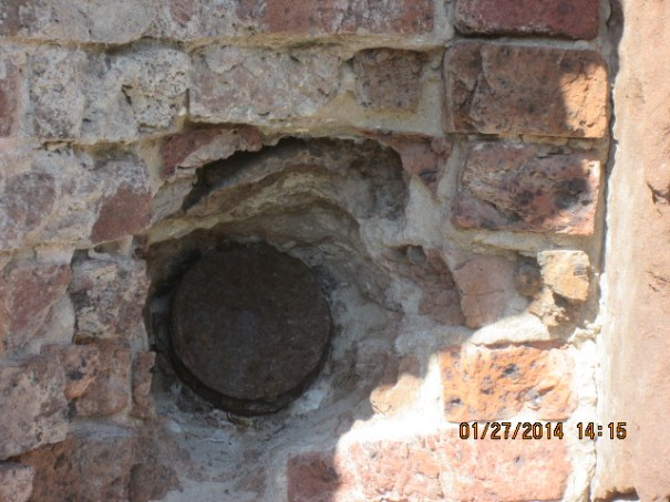 A round stuck in the brick wall.