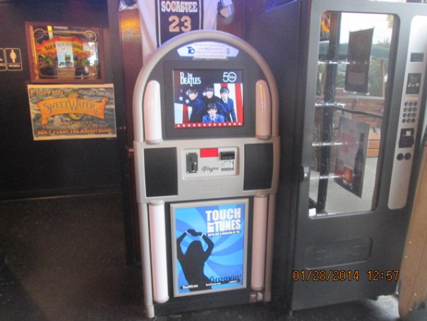 Digital iTunes jukebox with touch screen interface.