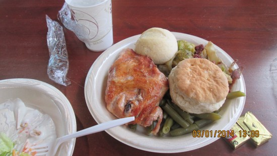 Baked chicken, green beans, scalloped potatoes, rolls and biscuits.