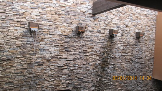 Water feature on rock wall.