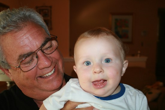 Chris and a happy grandson.