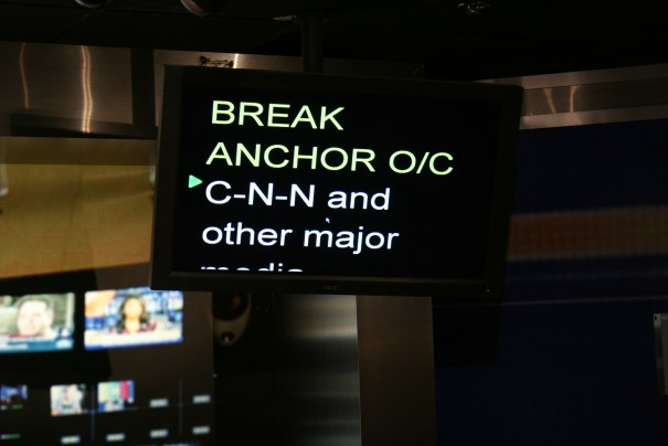 The teleprompter is directly above the camera and creates the illusion that the anchor is looking directly at us.  No more that 4 words in a sentence so the anchor's eyes won't move left to right as they read, to further the illusion.