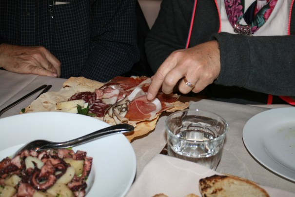 I almost got a gout attack just looking at their hot flat bread platter of meats.