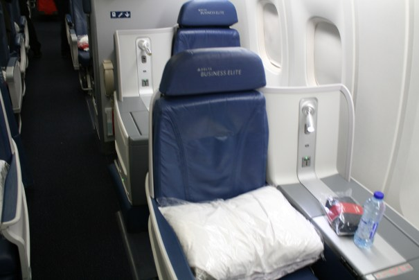 Business elite.  You get your own little fort.  You can lean almost all the way back, no one behind you.  Your feet go up like a lazy boy into the cavity of no seat directly in front of you.  Why couldn't we have been rich instead of so good looking?