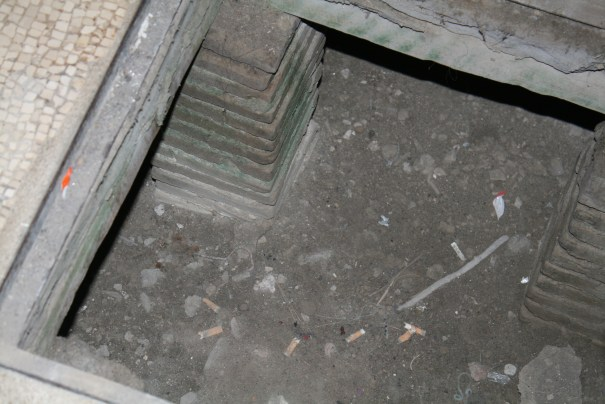 Crawl space under the floor, original construction.  Smokers just think the whole world is their ashtray.