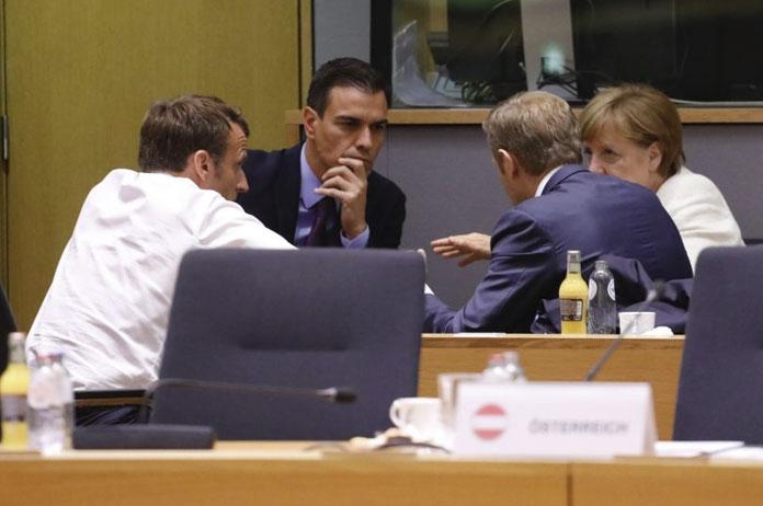 Emmanuel Macron, Pedro Sánchez, Angela Merkel, y Donald Tusk