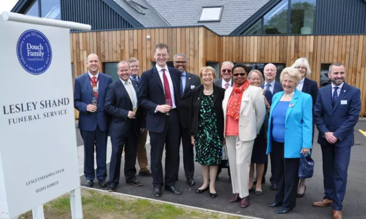 Michael Tomlinson MP, centre, Nick Douch to his left and other staff and dignitaries at the opening of the Lesley Shand branch in Corfe Mullen.