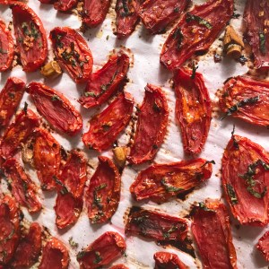 Easy homemade oven roasted tomato paste is a great way to preserve your tomato harvest. This tasty paste is so much better than the store bought tomato paste. It is freezable and if stored correctly can last very long in the fridge.